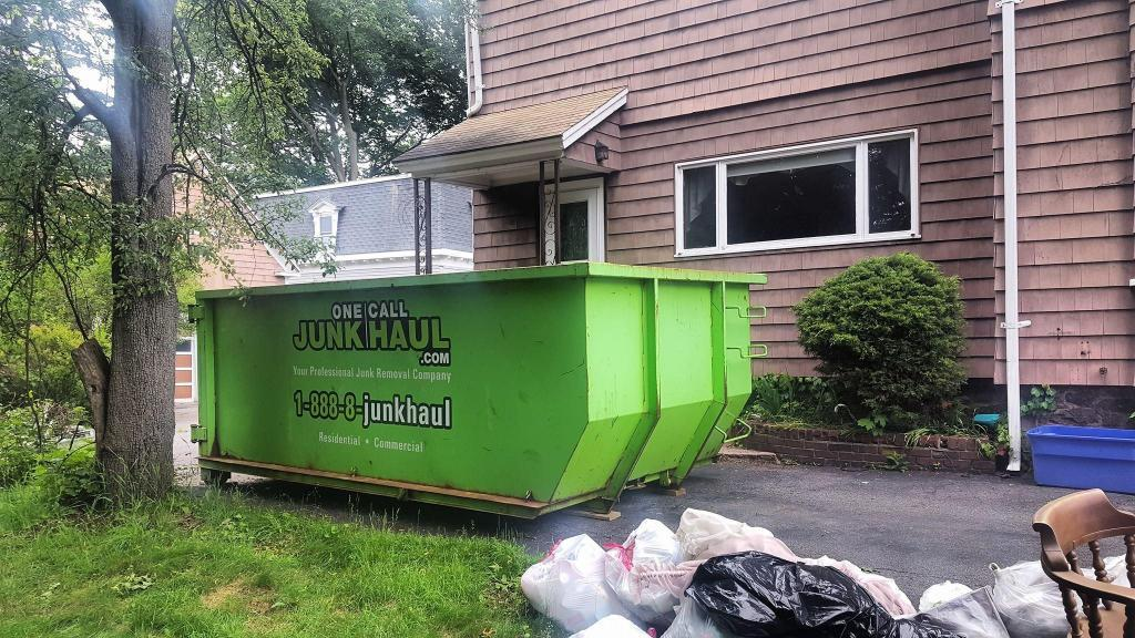 One Call Junk Haul Dumpster outside of Home
